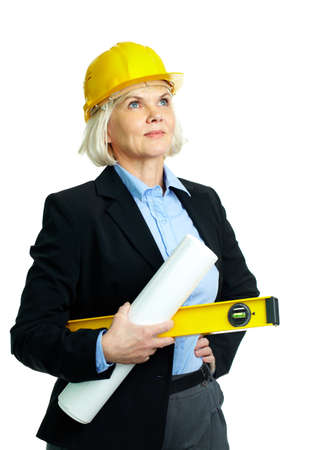 Portrait of confident businesswoman in helmet holding rolled blueprints and instrument photo