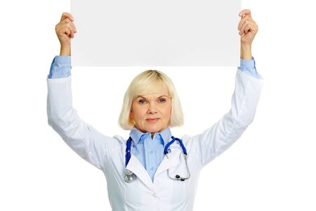 Female doctor holding a banner above her head photo