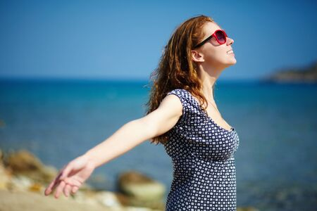 the warmth: Young pretty woman enjoying the sun and the warmth Stock Photo