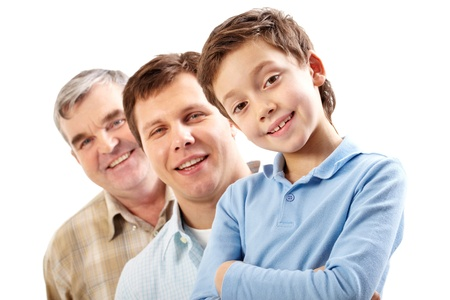 Three male members of the family presenting three generations smiling at camera Stock Photo - 12328719