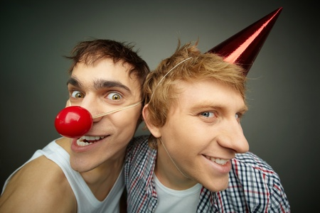 Two funny guys making faces at camera celebrating fool�s day photo