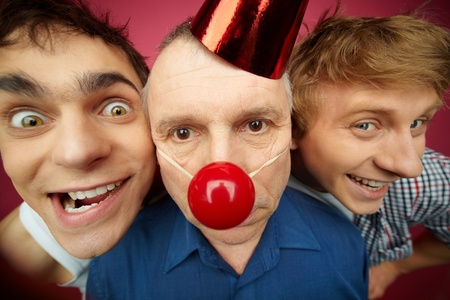 Two crazy guys play a senior man up on fool�s day photo