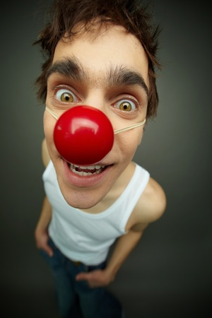 silliness: Close-up of a buy looking at camera with a smile, all fool's day Stock Photo