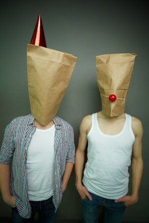 jokes: Two guys standing in front of camera in paper bags celebrating fool�s day Stock Photo