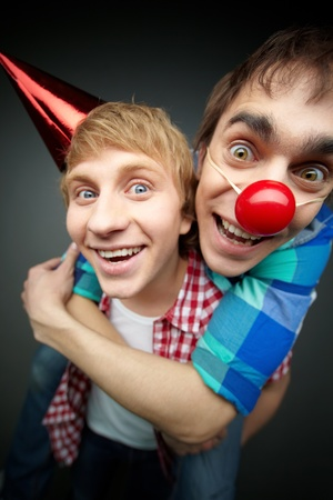 silliness: Guy holding his friend piggyback at a fool�s day party
