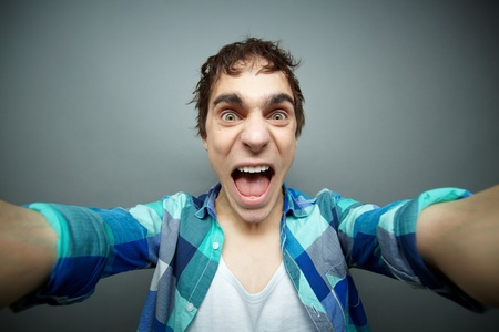 dreadful: Crazy guy screaming at camera while shaking it, fool�s day series