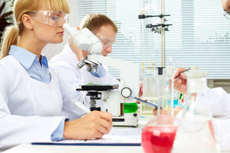 Scientists studying substances at laboratory and taking notes Stock Photo - 12380938