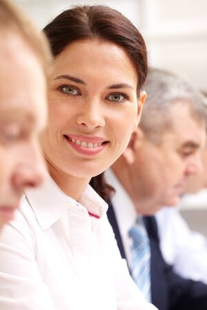 Beautiful woman taking part in business meeting and smiling at camera Stock Photo - 12381093