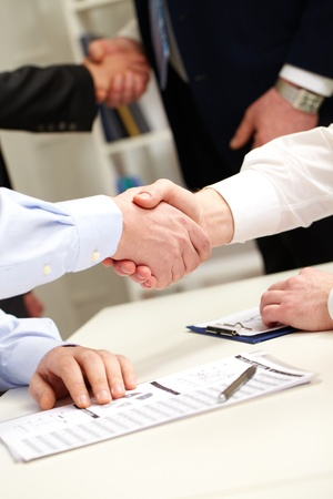 Business people shaking hands after successful negotiations photo