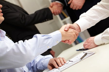 handshaking: Business people shaking hands after successful negotiations Stock Photo