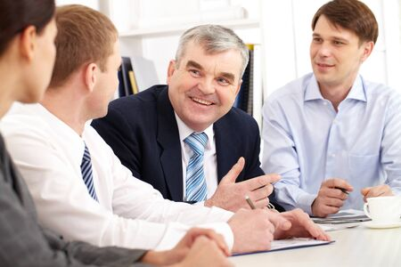 matters: Four people discussing business matters Stock Photo