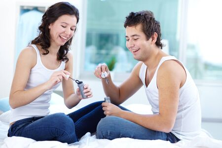 Happy couple having fun blowing soap bubbles photo