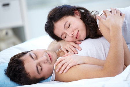 Lovers sleeping together in bed Stock Photo - 12381181