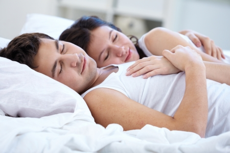 Lovers sleeping together in bed photo