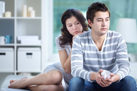 unhappy family: Unhappy lovers sitting together indoors
