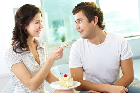 Lovers eating cake together photo