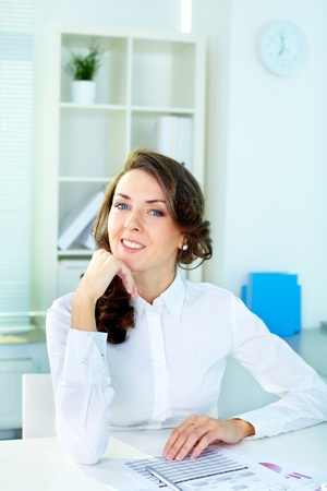 Vertical shot of a beautiful lady at office, secretary or business woman photo
