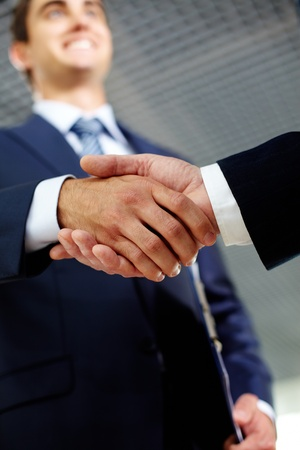Two businessman happily shaking hands indicating successful negotiations photo