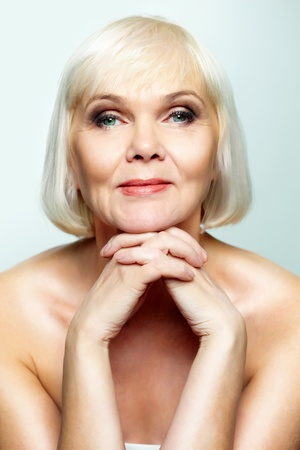 undressed: Mature lady looking calmly at camera
