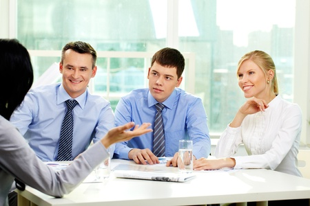 Positive business people listening attentively to their leader Stock Photo - 12620674