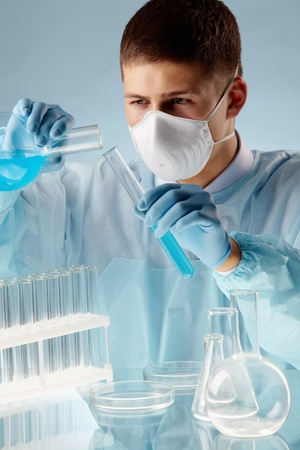 reagents: Male scientists mixing reagents in lab conditions