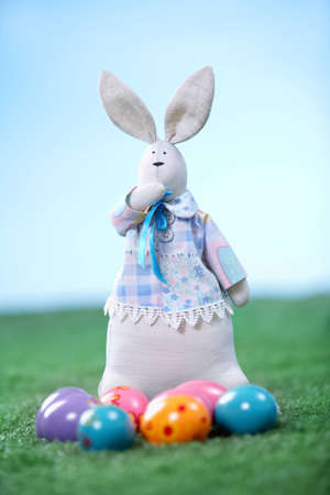 Vertical shot of an Easter bunny with eggs lying in front of it Stock Photo - 12620628