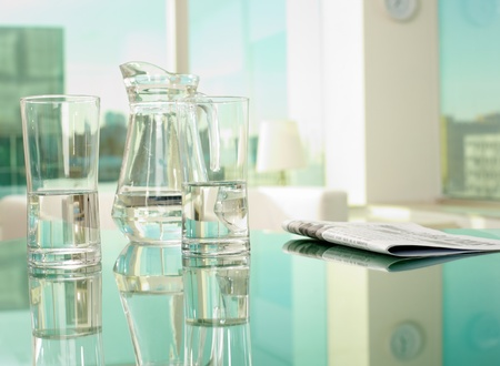 boardroom: Workplace with glassware and newspaper