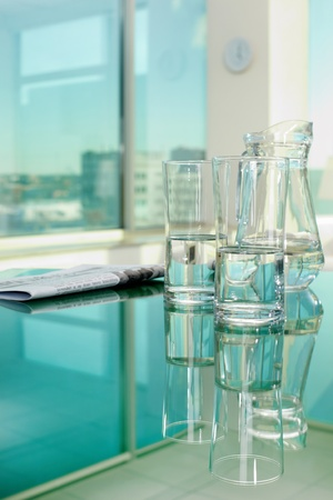 fresh news: Close-up of glassware and newspaper on table