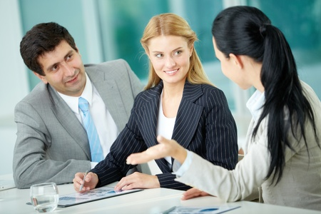 Three business people discussing new project in office Stock Photo - 12620439