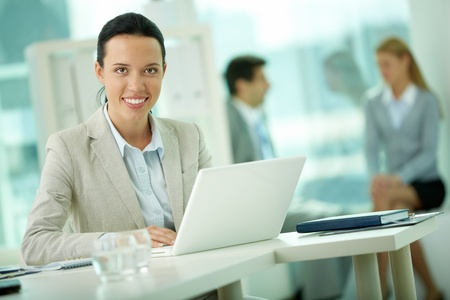 Portrait of pretty secretary looking at camera while working Stock Photo - 12620549