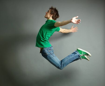 man flying: Artistic shot of a guy jumping high and posing meanwhile Stock Photo