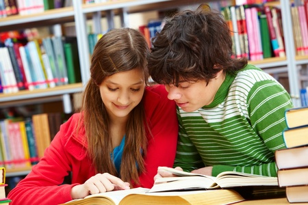college boy: Friends spending time together studying at library Stock Photo
