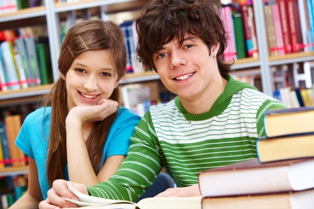 Portrait of positive students looking at camera and smiling photo