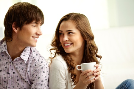teen couple: Happy lovers looking at each other and flirting
