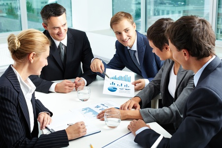Positive business people holding a meeting to sum up the results of the year Stock Photo - 12620333