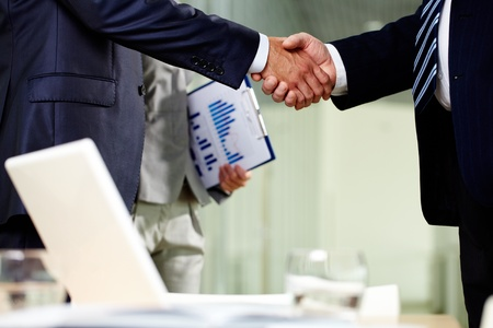 Close-up of two men handshaking after making agreement Stock Photo - 12620258