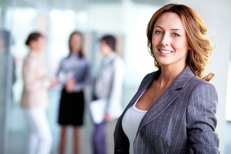 business leader: Image of pretty business leader looking at camera