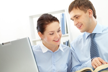 Photo of smart businessman and his pretty colleague interacting in office photo