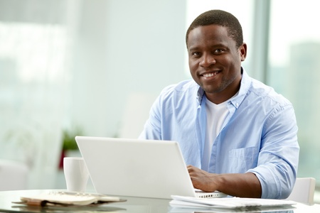 Image of young African businessman looking at camera at workplace Stock Photo - 12873254
