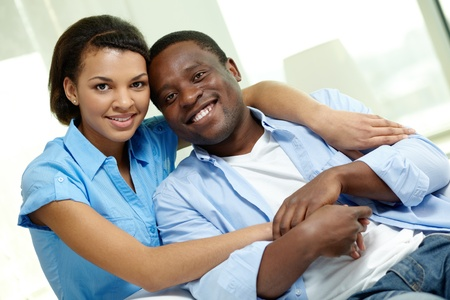 Image of young African couple looking at camera photo