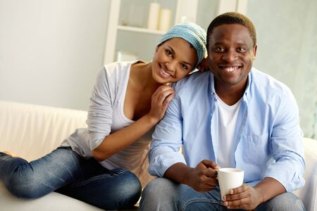 africanamerican: Image of young African couple looking at camera with smiles Stock Photo