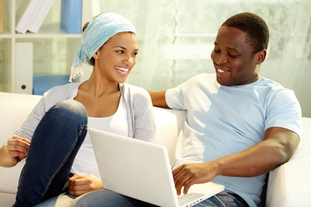 couple home: Image of young African couple spending free time at home