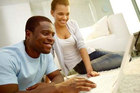 Image of young African couple networking at home Stock Photo - 12873235