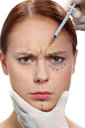 Świeże kobieta ze znakami uwagę na twarz podczas zabiegu BOTOX Zdjęcie Seryjne