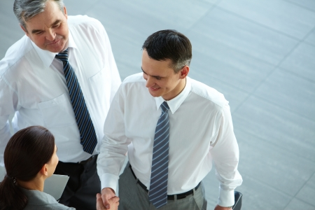 Image of business partners handshaking after signing contract Stock Photo - 12873278