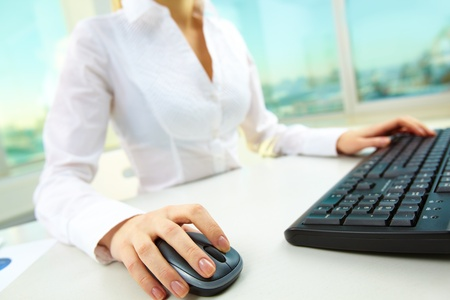 Image of female hands pushing keys of a computer mouse and keyboard Stock Photo - 12872773