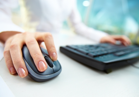 internet: Image of female hands clicking computer mouse Stock Photo