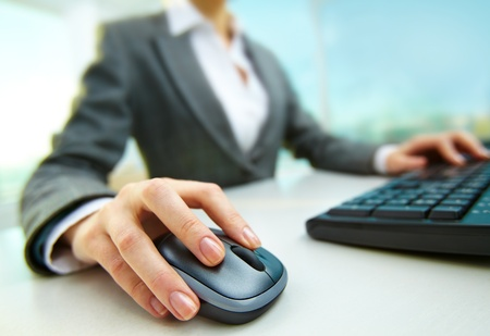 Image of female hands pushing keys of a computer mouse and keyboard Stock Photo - 12872780