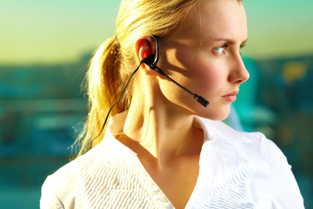 helpline: Image of pretty woman with headset Stock Photo