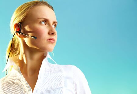Image of pretty woman with headset on blue background Stock Photo - 12872802